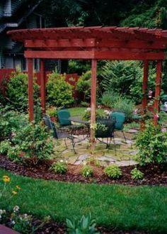 Round pergola to create a garden area around a round patio.