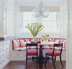 have a seat on this pretty red & white striped breakfast nook bench