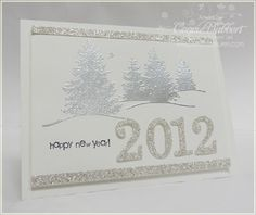 shimmer you way into a new year with this handmade silver and white card the tree scene has been embossed with silver while the year and border accents