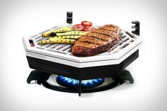 The Element Indoor Smokeless BBQ ($225) - This unique cooking system uses a gas or electric stove element to heat a bed of lava rocks, creating the flavor of a traditional grill without the smoke or charcoal dust.