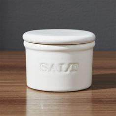 """Shop Ceramic Salt Cellar.  A rustic essential for the home chef, this lidded stoneware cellar in creamy white with subtly antiqued """"Salt"""" embossing lets you pinch just the right amount of your favorite fine, coarse or artisanal salt variety."""