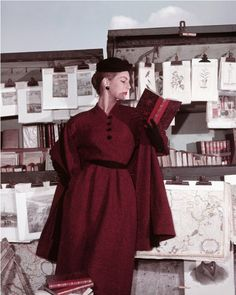 Fiona Campbell-Walter reading at the Bouquinistes. For ELLE Winter Collection, Paris 1953. Photo by Georges Dambier.
