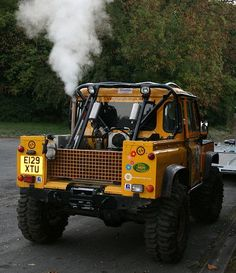 Land Rover Defender 90 Td5 pickup truck in yellow