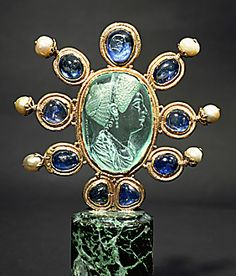 ROMAN CAMEO 1ST-3RD CE  Intaglio of Julia, daughter of Titus. Aquamarine (2nd half of 1st CE) signed Evodos. Carolingian frame (9th) surrounded by 9 sapphires and 6 pearls.  Bibliotheque Nat.,Cabinet des Medailles, Paris, France