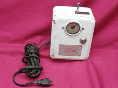 """Intriguing old (rare?) coin-operated 120-volt """"Meter-Matic"""" with timer. I guess a battery is enclosed and you can add coins to get the desired number of minutes of electricity that you need ...  but for what?? (See close-up photo.)"""