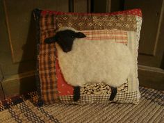 Black Face Sheep On Old Quilt Pillow