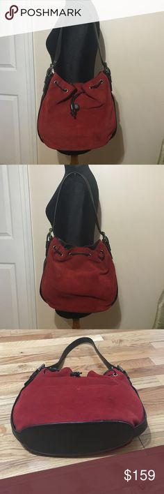 Donald j Pliner bucket bag Thick soft red suede with expresso brown leather accents and silver hardware. Lined in Donald j Pliner expresso brown fabric. 2slip pockets and 1 zippered pocket. Magnetic and drawstring closure. Leather base adjustable leather shoulder strap. 14in wide 11in tall 101/2 in shoulder strap. Donald J. Pliner Bags Hobos
