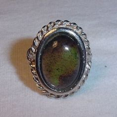 """Mood ring. Purple was passionate. I asked my dad what that meant, and he said """"friendly"""". :)  Miss you, Dad!"""