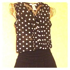 Lot of 2 tops Cute and simple. One is black solid with lace around the neck. The other is black with white polka dots and button down. Both size small. Good used condition Tops Blouses