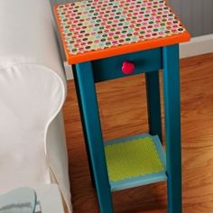 Fix up a thrift store table with paint, Mod Podge and scrapbook paper.  Try this on the bar shelves?