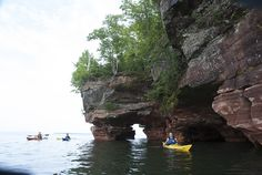 Apostle Islands National Park is a stunning island chain on the coast of Lake Superior in Wisconsin Kayaking Near Me, Canoeing, Canoe Camping, Canoe And Kayak, Lake Superior, Paddle Boarding, Islands, Places To Go, National Parks