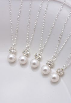 LISTING IS FOR ALL 5 NECKLACES:  These 5 lovely necklaces feature sterling silver chain and spring clasps. An 8mm white Swarovski pearl (5 colors