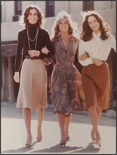 this is what women wore in the 70s, mostly skirts or dresses and a nicer top with their hair down.