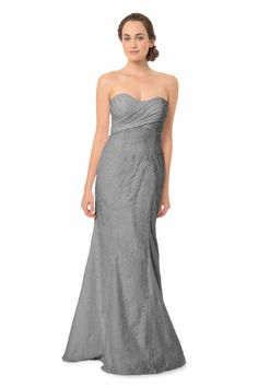 Strapless sweetheart lace gown with asymmetrical draped bodice and fit-and-flare silhouette.