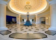 A beautiful hand-painted dome ceiling that measures 54 feet across spans most of the incredible lobby of the Waldorf Astoria in Orlando. Underneath, there is a magnificent handcrafted clock