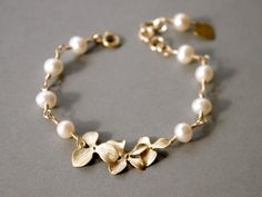 Orchid Jewelry  Orchid Flowers and Pearl Bracelet by SarahOfSweden