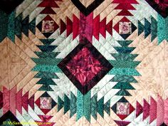 Close-up of pineapple quilt with gold thread.
