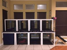 IKEA MELLTORP tables converted to Canine Condo_nice looking way to deal with multiple crates.  Even if only the bottom row, the table top would be good to have for stuff.