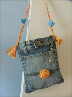 Blue Jean Handbag - made out of old jeans. Finished off with handmade rosettes and a silver heart pendant. Small size makes it perfert for carrying just the essentials. - fabric handbags, shopping handbags, real leather handbags *ad