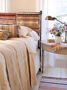 "Draped rugs used as ""headboard."" Great ideas for making flea market finds look chic!"