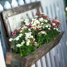 Remember Fragrance - The best container gardens don't just look good - they smell great, too. Incorporate a few fragrant plants into your containers and be sure to site them where you can enjoy them. For example, here dianthus hangs from a picket fence, bringing it that much closer to nose level.
