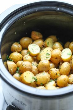 Slow Cooker Garlic Parmesan Potatoes - Crisp-tender potatoes with garlicky parmesan goodness. Its the easiest side dish you will ever make in the crockpot!