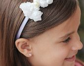 Rosette bow attached to satin covered headband (white)