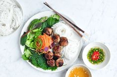 A tasty recipe for Bun Cha, a classic Vietnamese noodle salad with grilled pork meatballs.