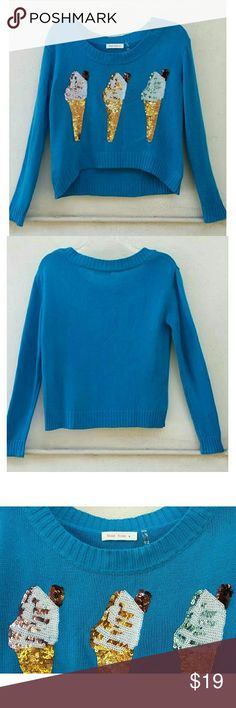 "ICE CREAM SUNDAE Crop High Hi Low Sweater Top S New without tag. Adorable blue with sequined ice cream cones cropped high low hem sweater. 100% acrylic. Size : Small  (juniors).  Underarm across : 19"" Length : approx 19"" front 21"" back  Similar style to : Billabong, Forever 21, Brandy Melville, Zara   Bundle 2 + items to save on shipping! :) Love Tree Sweaters Crew & Scoop Necks"