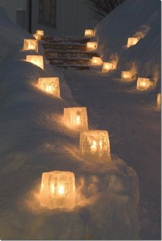 Ice block lanterns in the snow. Love it! Great idea for outdoor lighting in the winter snow.
