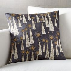 Shop Modern Christmas Pillow. Inspired by a vintage Christmas card, this contemporary pillow patterns ivory appliquéd trees and gold starbursts on rich pewter-colored satin. Pillow reverses to solid.