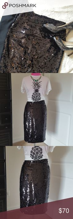 Express  Black Sequin Pencil Skirt Express pencil skirt. Back zip enclosure. Back vented slip. Covered in sequins front and back.  No missing sequins. Great condition.  No tears, stains etc. Express Skirts Pencil