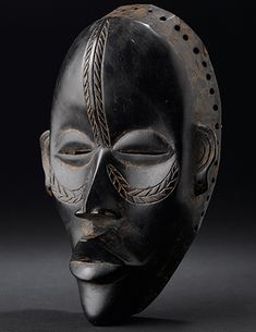 Native people carved ceremonial masks like this by hand, ...