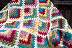 Mitered Granny Square Blanket. Great photo tutorial (written instructions as well) on how to crochet the mitered squares.