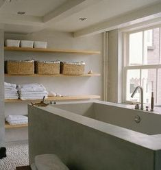 Great bathroom. Love the sparse, raw look (no curtains, open non-painted shelves, etc)