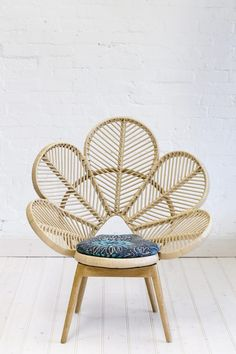 Rattan chair design is made of rattan, a vine-like palm that you can find in the tropical jungles of China, Asia, and Malaysia. The Philippines are one of the biggest sources of rattan. Cane Furniture, Bamboo Furniture, Natural Furniture, Outdoor Furniture, Chair Design, Furniture Design, Rattan Peacock Chair, Love Chair, Handmade Cushions