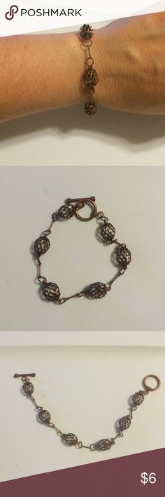 NWOT handmade bracelet Very cute handmade bracelet. Copper look to it. Balls, circles, and lines for design. Jewelry Bracelets