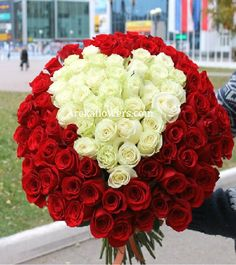 HEART DESIRE – 70 ROSES 70 Red & White color roses with seasonal fillers make this amazing bunch in elegant paper wrapping with a ribbon. Premium Roses bouquet with white roses in the middle. Flowers: 70 Stems (40 Red & 30 White) Free message card