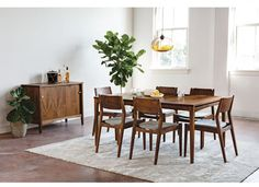 Whitman Extension Dining Table With Sideboard Chairs In Eastern Walnut