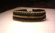 Cross-stitch bracelet....cotton thread in black and gold