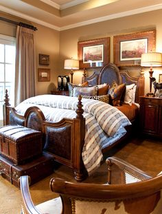 Beautiful bedroom....love to see old suitcases and trunks used this way