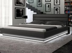 Incredible platform bed lit with light emitting diodes. Talk about setting a romantic mood! I may rethink LED furniture.
