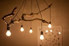 light bulbs hanging through branch. Rustic chandelier/lighting idea that is just great! popuprepublic.com