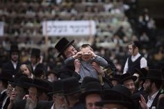 Gathering of Satmar Hasidic Jews in NY.  Thousand attend the celebration of the 68th anniversary rescue of their founder Rabbi Joel Teitelbaum from the Nazis; CSMonitor.com