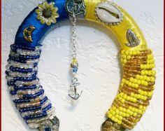 Santeria.yoruba  Dressed lucky iron Horseshoe for  Orishas. Osha. Herraduras amuletos  para Santos. Osha