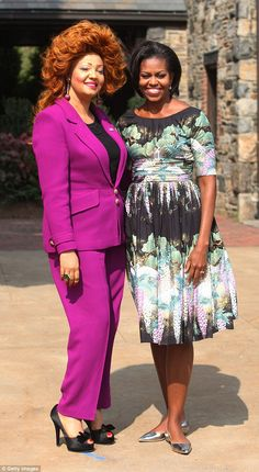 Cameroon's flamboyant first lady Chantel Biya (pictured with Michelle Obama) , has a hairstyle named after her and loves to wear Dior and Chanel Michelle Obama, Chantal Biya, Presidents Wives, Hairstyle Names, My Black Is Beautiful, African Beauty, African Dress, Style Icons, Peplum Dress