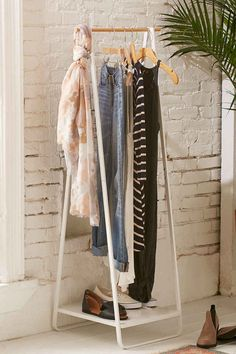 A minimalist tower clothing rack to hang your favorite pieces like art — or plan your outfit for the next morning.