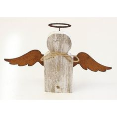 This rustic angel is 100-percent recycled from old wood in Texas. Unique, hand-crafted using solid wood, cut metal, and jute, this rustic-styled wall decor will look great hanging in any room or on a mantle.