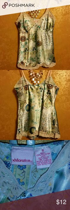 Sweet Satin Tank Top Satiny smooth tank/cami with beige lace trim, adjustable beige straps, small side slits to hang nicely. Turquoise, cream, and some yellow, green, and brown in floral pattern. Unlined, not sheer. Too small for me! Xhilaration Tops Tank Tops