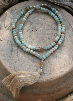 Mala made of 108, 6 x 8 mm - 0.236 x 0.315 inch, beautiful frosted Amazonite gemstones and decorated with faceted Agate and Hematite - Made by look4treasures